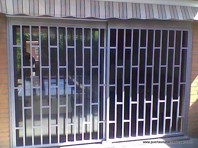 Rejas de seguridad rejas ballestas barcelona for Modelos de rejas de fierro para puertas